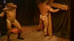 Muscle Stud On St Andrews Cross Flogged By His Real Life Partner.