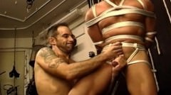 Group Cbt Bottom Is Suspended As Two Other Muscular Dudes Work His Balls.