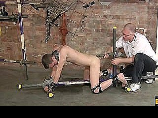 Cuffed Into A Doggy Position And Learning How To Take A Huge Dildo