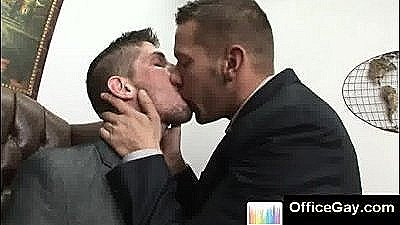 Good Looking Gay Studs Kissing At The Office