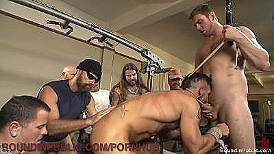 Hairy Muscled Hunk Gets Gangbanged At The Gym