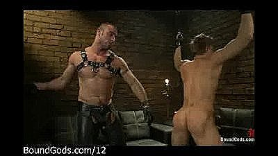 Bound Suspended Guy Gets Flogged By Master In Leather